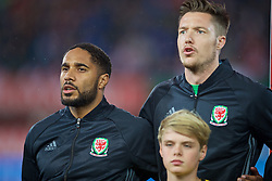 VIENNA, AUSTRIA - Thursday, October 6, 2016: Wales' captain Ashley Williams and goalkeeper Wayne Hennessey sing the national anthem as they line-up before the 2018 FIFA World Cup Qualifying Group D match against Austria at the Ernst-Happel-Stadion. (Pic by David Rawcliffe/Propaganda)