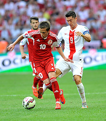 13.06.2015, Nationalstadion, Warschau, POL, UEFA Euro 2016 Qualifikation, Polen vs Greorgien, Gruppe D, im Bild ROBERT LEWANDOWSKI, JANO ANANIDZE // during the UEFA EURO 2016 qualifier group D match between Poland and Greorgia at the Nationalstadion in Warschau, Poland on 2015/06/13. EXPA Pictures © 2015, PhotoCredit: EXPA/ Pixsell/ RAFAL RUSEK<br /> <br /> *****ATTENTION - for AUT, SLO, SUI, SWE, ITA, FRA only*****