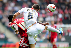 Bristol City's Jay Emmanuel-Thomas loses out to a header to Milton Keynes Dons' Shaun Williams  - Photo mandatory by-line: Dougie Allward/JMP - Tel: Mobile: 07966 386802 24/08/2013 - SPORT - FOOTBALL - Stadium MK - Milton Keynes -  Milton Keynes Dons V Bristol City - Sky Bet League One