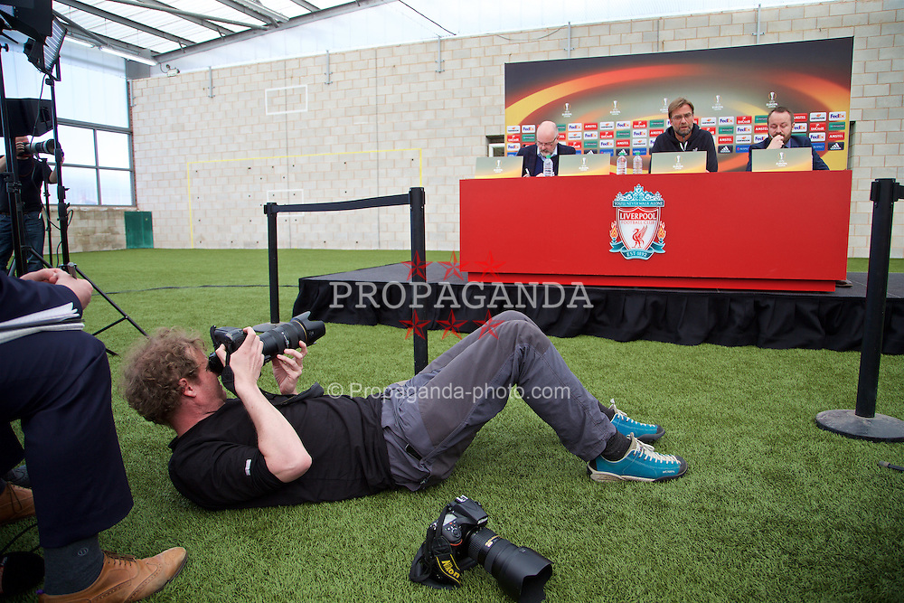 LIVERPOOL, ENGLAND - Wednesday, April 13, 2016: Liverpool's a photographer takes an unusual angle to shoot manager Jürgen Klopp during a press conference at Melwood Training Ground ahead of the UEFA Europa League Quarter-Final 2nd Leg match against Borussia Dortmund. (Pic by David Rawcliffe/Propaganda)
