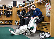 Goaltending coach Scott Meyer (from left) and RoughRiders goalie Matt McNeely talk as they watch game tape at the Cedar Rapids Ice Arena, 1100 Rockford Road SW, in Cedar Rapids on Tuesday, December 13, 2011. (Stephen Mally/Freelance)