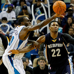 December 21, 2011; New Orleans, LA, USA; New Orleans Hornets small forward Quincy Pondexter (20) knocks the ball away from Memphis Grizzlies small forward Rudy Gay (22) during the second half of a game at the New Orleans Arena. The Hornets defeated the Grizzlies 95-80.  Mandatory Credit: Derick E. Hingle-US PRESSWIRE