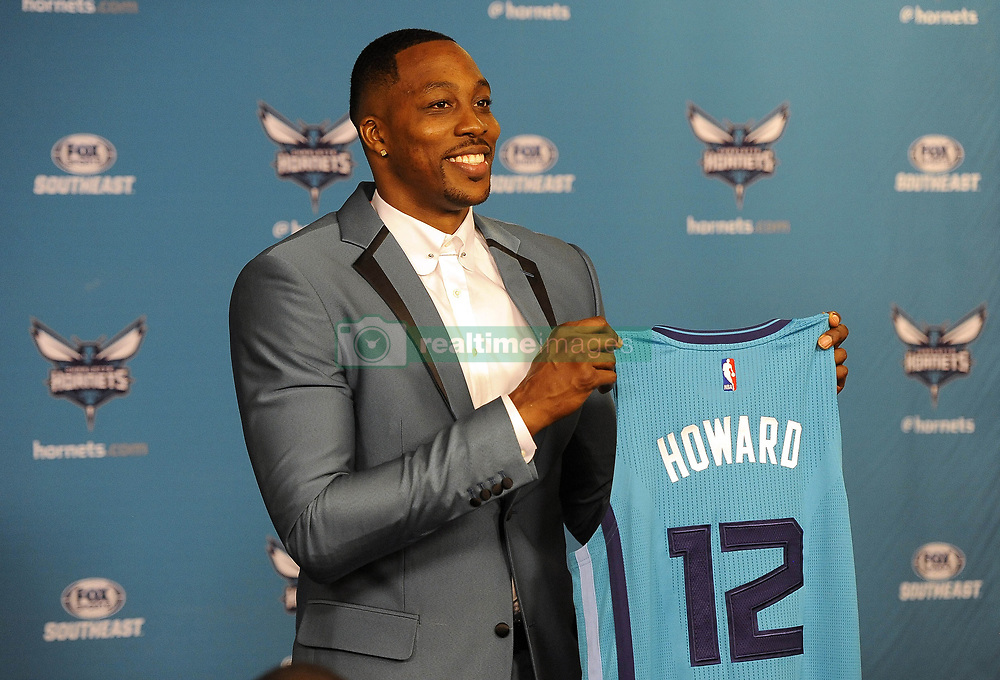 June 26, 2017 - Charlotte, NC, USA - The Charlotte Hornets' new center Dwight Howard holds up his jersey during a news conference on Monday, June 26, 2017 at the Spectrum Center in Charlotte, N.C. (Credit Image: © David T. Foster Iii/TNS via ZUMA Wire)