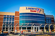 Exterior architectural photos of a bank in Fayetteville, Arkansas, while it was under construction Photography of the exterior of Liberty Bank in Fayetteville, Arkansas, while it was under construction. The idea was to create images to be used for advertising and a shareholder's meeting that did not show the construction