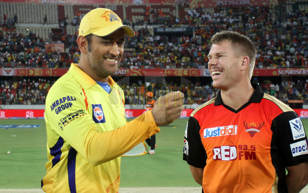 Chennai Super Kings captain MS Dhoni and Sunrisers Hyderabad captain David Warner during the toss of the match 34 of the Pepsi IPL 2015 (Indian Premier League) between The Sunrisers Hyderabad and The Chennai Super Kings held at the Rajiv Gandhi International Cricket Stadium in Hyderabad, India on the 2nd May 2015.<br /> <br /> Photo by:  Vipin Pawar / SPORTZPICS / IPL