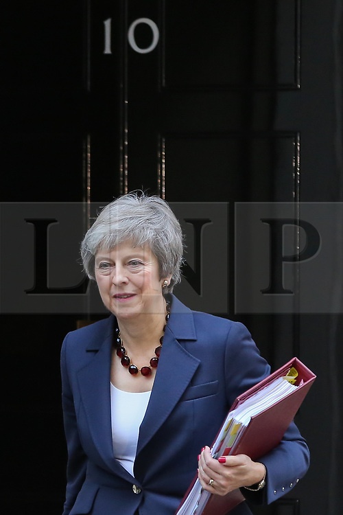 © Licensed to London News Pictures. 14/11/2018.London UK. Prime Minister Theresa May departs from Number 10 Downing Street to attend Prime Minister's Questions (PMQs) in the House of Commons.   Photo credit: Dinendra HariaLNP
