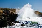 Ocean waves break against rocky outcrops along the Central Coast of California.