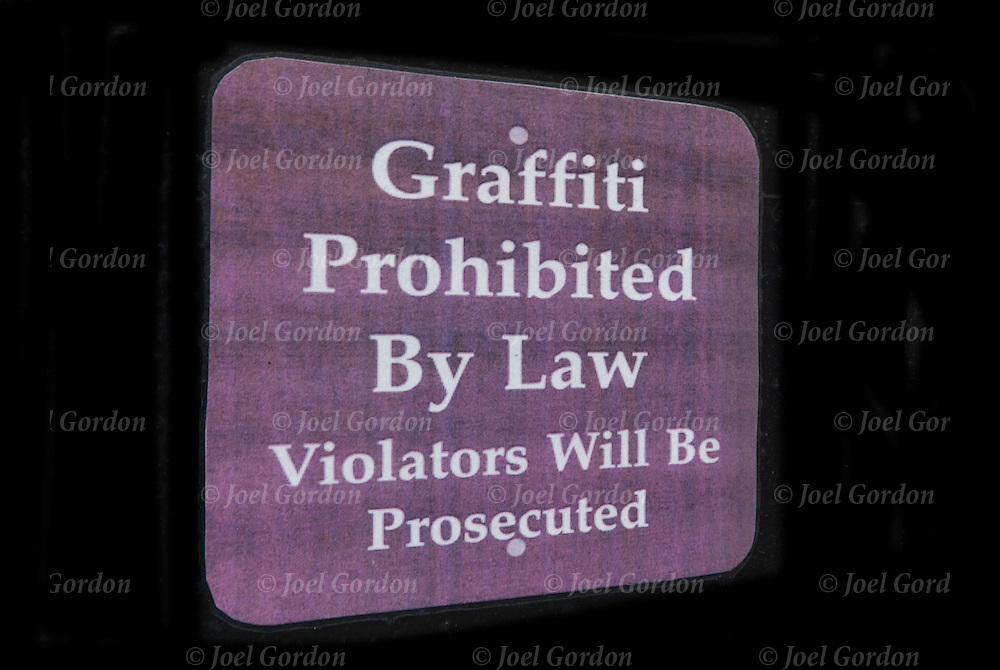 "Sign on side of building ""Graffiti Prohibited by Law Violators will be Prosecuted """