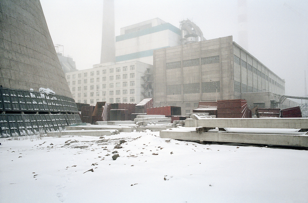 Birth of a new coal power station:<br /> China is on track to add 562 coal-fired plants - nearly half the world total of plants expected to come online in the next eight years. The World Bank concludes that pollution is costing China an annual 8-12% of its $1.4 trillion GDP in direct damage, such as the impact on crops of acid rain, medical bills, lost work from illness etc. China's energy consumption accounts for approximately 53% of East Asia's (excluding Japan) total energy consumption. By 2025, projections indicate that China will be responsible for approximately 14.2% of world energy consumption. For every $1 of gross domestic product produced, China spends three times the world average on energy. Tonghua, Jilin, China. 2007
