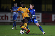 Medy Elito of Cambridge United and Michael Woods of Hartlepool United in action during the EFL Sky Bet League 2 match between Cambridge United and Hartlepool United at the Cambs Glass Stadium, Cambridge, England on 14 March 2017. Photo by Harry Hubbard.