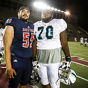 Matt Armstrong #55 of the Boston Brawlers and Adrian Battles #70 of the Blacktips, who attended the same high school, pose for a photo following the first ever Boston Brawlers home game at Harvard Stadium on October 24, 2014 in Boston, Massachusetts. (Photo by Elan Kawesch)