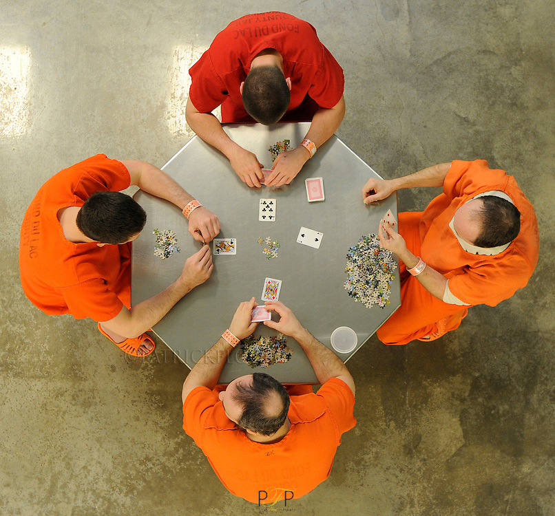 Inmates play cards in one of the cells at the Fond du Lac county jail. Tuesday, January 8, 2013.  Patrick Flood / The Reporter Media.