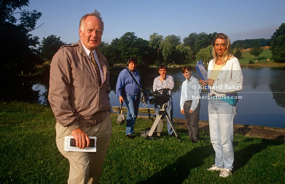 Television documentary film maker Desmond Wilcox (1931 – 2000) and production crew during the filming of a programme. The portrait is with members of his colleagues during a break in filming for a programme about Hampstead Heath in London. Desmond John Wilcox (21 May 1931 – 6 September 2000) was a British documentary maker at the BBC and ITV. He was producer of This Week, Man Alive, and That's Life! and married to television presenter Esther Rantzen in 1977. He died of a heart attack in Paddington, London, in 2000, aged 69 after converting to Judaism in 1992.