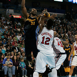 28 January 2009: Denver Nuggets center Nene Hilario (31) shoots over New Orleans Hornets center Hilton Armstrong (12) during a 94-81 win by the New Orleans Hornets over the Denver Nuggets at the New Orleans Arena in New Orleans, LA. The Hornets wore special throwback uniforms of the former ABA franchise the New Orleans Buccaneers for the game as they honored the Bucs franchise as a part of the NBA's Hardwood Classics series. .