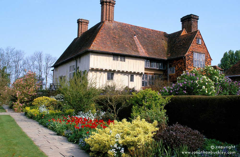 The house and long border in early May