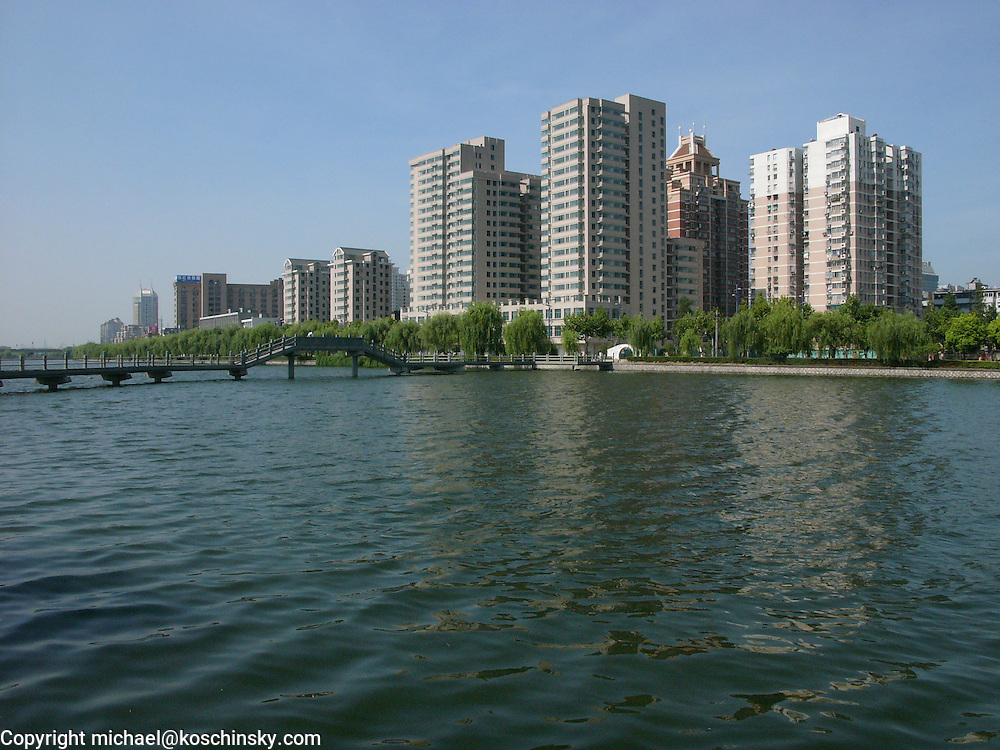 Modern City Skyline at Hangzhou, China,  waterfront highrise, chinese bridge foreground