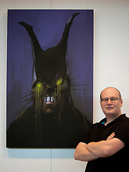 © Licensed to London News Pictures. 22/10/2012. LONDON, UK. Digital artist Lee Oliver, stands next to his digital painting 'Rabbit Head' created for the computer game 'Batman - Arkham City', at an exhibition at London's City Hall. The exhibition, entitled 'The Games Art Festival', showcases the best of videogame art and runs from the 22nd to the 26th of October as part of the 'London Games Festival 2012'. Photo credit: Matt Cetti-Roberts/LNP