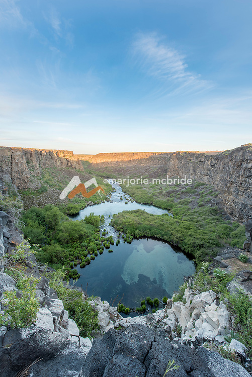 Sunrise view of underground spring in the ancient plunge pools of  Box Canyon State Park in Wendell, Idaho.