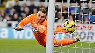 Jak Alnwick of Newcastle United cant stop Danny Ings (not shown) of Burnley scoring during the Barclays Premier League match at St. James's Park, Newcastle<br /> Picture by Simon Moore/Focus Images Ltd 07807 671782<br /> 01/01/2015