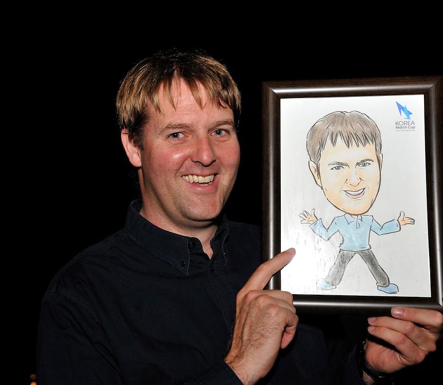 WMRT Tour Director Craig Mitchell is presented with a caricature. Photo:Chris Davies/WMRT
