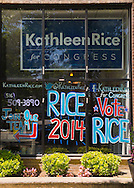 Garden City South, New York, U.S. - August 11, 2014 - Kathleen Rice's Campaign Field Office is the press conference location where Rice, the Democratic candidate for Congress in New York's 4th Congressional District, was endorsed by NARAL Pro-Choice New York and Planned Parenthood of Nassau County Action Fund, NARAL. The office's front window has Rice 2014 in red white and blue. Rice is in her third term as Nassau County District Attorney, Long Island.