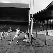 27/03/1966<br /> 03/27/1966<br /> 27 March 1966<br /> National Hurling League, Division II: Antrim v Kerry at Croke Park, Dublin.<br /> Kerry's fourth goal was scored by D. Lovett (not in picture), while Kerry forwrads, T. Nolan (13) and E. O'Sullivan gave support . The antrim goalie, D. O'Neill is on the ground.