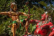 Hindu gods, papier mache models beside road, Bali, Indonesia.