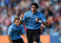 Uruguay's SEBASTIAN ABREU celebrates after scoring their goal against Bolivia during their 2010 World Cup qualifying soccer match in Montevideo, October 13, 2007<br /> URUGUAY beat BOLIVIA by 5-0. at the Centenario Stadium in MOntevideo Uruguay.<br /> © PikoPress
