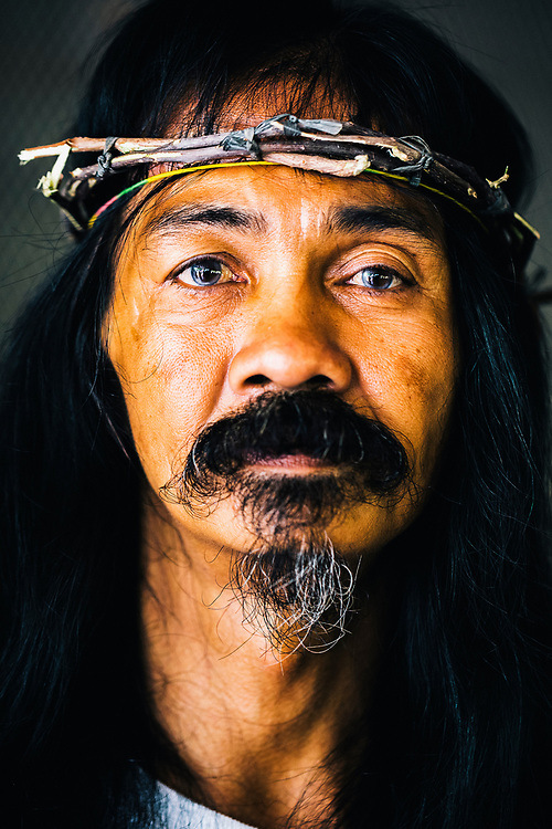 A portrait of Victor Caparas, a Filipino man from Cutud who has been nailing himself to a cross every Good Friday since 1991.