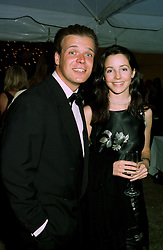 MR JOEL CADBURY and his goodfriend MISS SASHA COOKE, at a reception in London on 7th June 1997.LZA 113