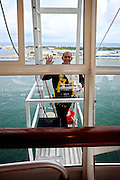 A crew member polish windows outside one of the reastaurants onboard the cruise ship Oasis of the Seas. The ship, currently the largest in the world, is owned by Royal Carribean Cruise Line.