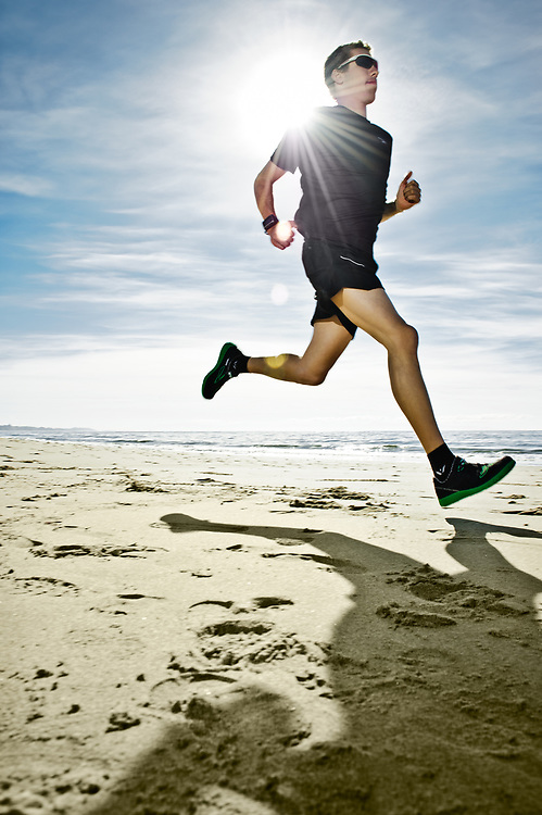 Triathlete Tommy Zaferes running at Rio Del Mar Beach | Magellan GPS