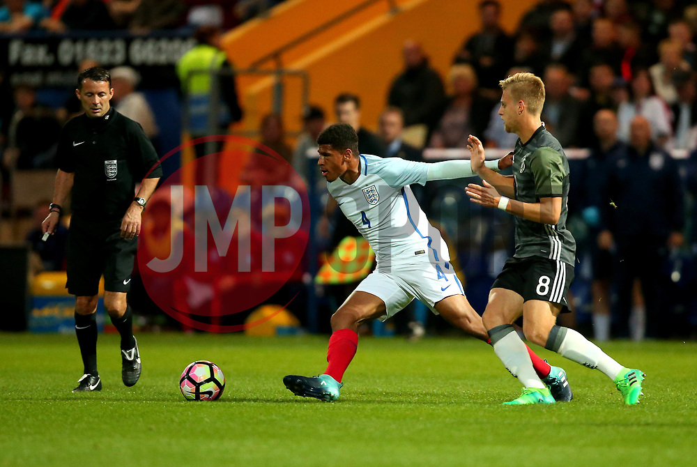 Marcus McGuane of England takes on Arne Maier of Germany Under 19s - Mandatory by-line: Robbie Stephenson/JMP - 05/09/2017 - FOOTBALL - One Call Stadium - Mansfield, United Kingdom - England U19 v Germany U19 - International Friendly