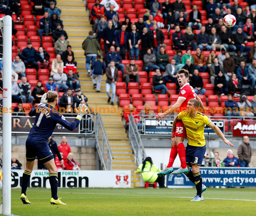 John Marquis of Leyton Orient beats Joe Skarz of Oxford United to the header during the Sky Bet League 2 match between Leyton Orient and Oxford United at the Matchroom Stadium in London. October 17, 2015.<br /> Carlton Myrie / Telephoto Images<br /> +44 7967 642437