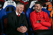 Manchester United interim Manager Ole Gunnar Solskjaer and Michael Carrick first team coach of Manchester United share a laugh during the Premier League match between Crystal Palace and Manchester United at Selhurst Park, London, England on 27 February 2019.