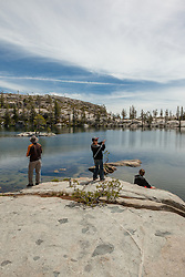 """Fishing Paradise Lake"" - Photograph of a man and two boys fishing from a boulder at Paradise Lake in the Tahoe National Forest."