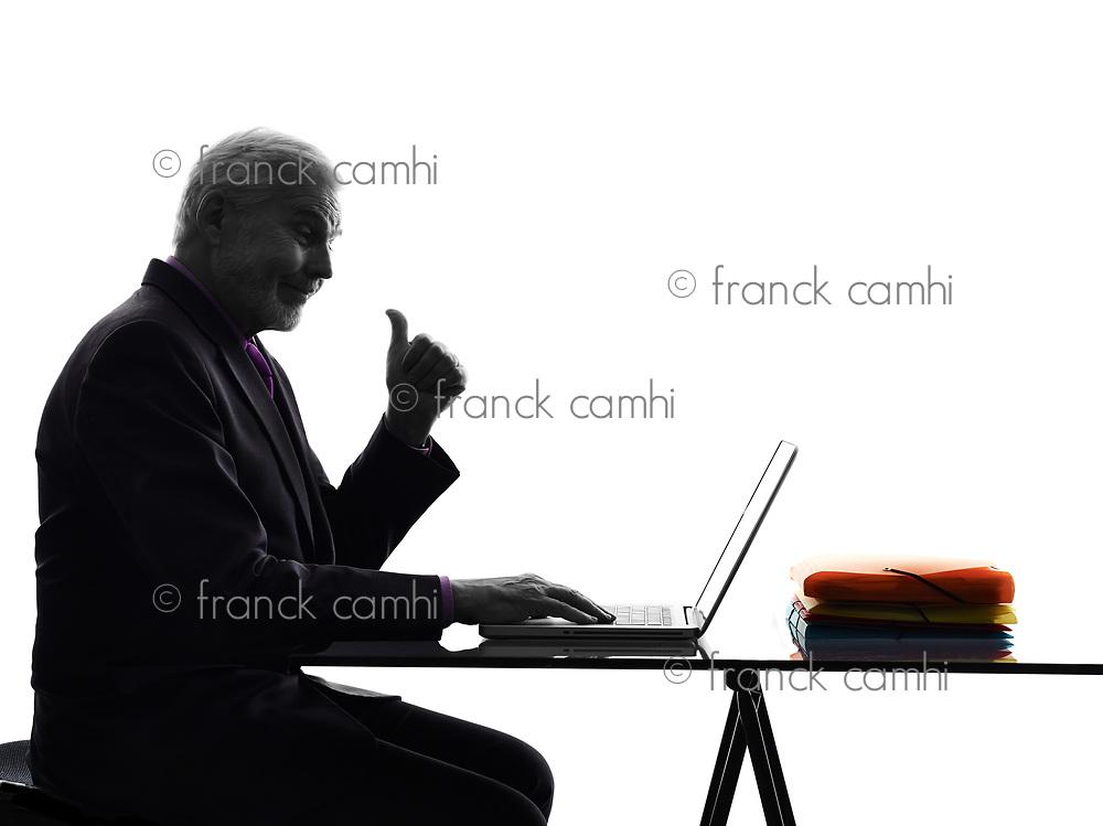One Caucasian Senior Business Man computing laptop thumb up Silhouette White Background