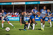 Drew Spence (Chelsea), Ini Umotong (Brighton) & Victoria Williams (Brighton) looking for the ball coming in from a corner kick from Guro Reiten (Chelsea) during the FA Women's Super League match between Brighton and Hove Albion Women and Chelsea at The People's Pension Stadium, Crawley, England on 15 September 2019.