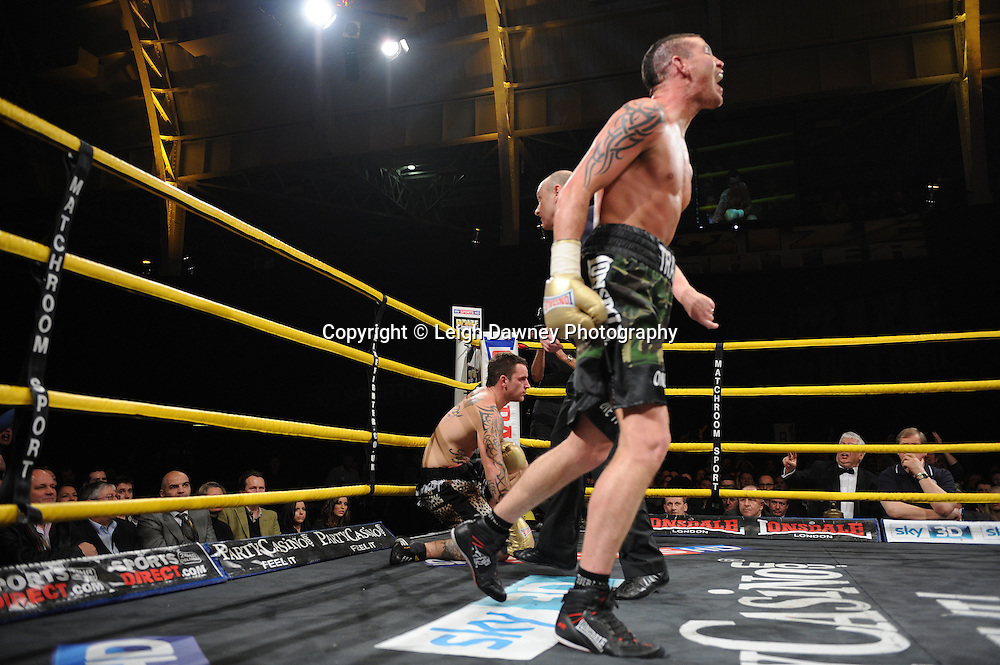 Travis Dickinson (camouflage shorts) defeats Sam Couzens, claiming the £32,000 prize fund at Prizefighter The Light Heavyweights II, Olympia, London on 29th January 2011. Photo credit © Leigh Dawney.