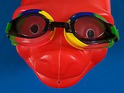 close up of a piggy bank's head with goggles