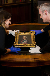 Pictured: Jill Brown and Michael Gormley from the Scottish National Portrait Gallery handle the painting valued at £1.1m with care. <br /> The Portrait of Bonnie Prince Charlie, newly acquired by the National Galleries of Scotland under the Acceptance in Lieu of tax scheme and valued at £1.1 million, is thought to have been created by artist Allan Ramsay in Edinburgh in 1745, at the height of the Jacobite rising. The portraits is the only one of the Prince Charles to have been painted in Britain.<br /> <br /> Ger Harley | EEm 30 March 2016