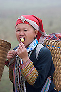 Hilltribe villages around Sapa. Red Dzao woman with lollipop.
