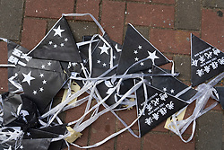 Hong Kong. 2 October 2019.  Many buildings and walls were vandalised and daubed with political slogans and anti-Chinese government and anti-police graffiti in Central and Wanchai districts by pro-democracy supporters on China's National Day on 1 October. Widespread clean-up operation is now underway. Black bunting lies on the ground. Iain Masterton/Alamy Live News.