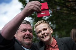 """© Licensed to London News Pictures . 16/08/2015 . Manchester , UK . Actor MAXINE PEAKE poses for a selfie with a member of the crowd at a """" Peterloo """" memorial at the site of St Peter's Field , where fifteen people were killed during a cavalry charge on a democracy protest , 196 years ago (16th August 1819) . Photo credit : Joel Goodman/LNP"""