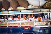 Nuns joke around on a crowded tuk-tuk in Mandalay, October 20th, 2015.