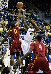 January 9, 2010; Berkeley, CA, USA;  Southern California Trojans forward Marcus Johnson (0) blocks a shot from California Golden Bears forward Theo Robertson (24) during the first half at the Haas Pavilion.  California defeated USC 67-59.