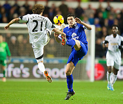 SWANSEA, WALES - Sunday, December 22, 2013: Everton's Gareth Barry in action against Swansea City's Jose Canas during the Premiership match at the Liberty Stadium. (Pic by David Rawcliffe/Propaganda)
