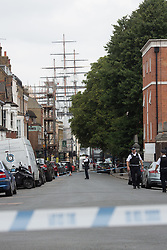 © Licensed to London News Pictures. 15/07/2017. Police have sealed off King William Walk and Nevada Street in Greenwich town centre today while a murder investigation takes place. A 31 year old man was stabbed by two men on mopeds after midnight. It has been reported that the victim had just left Oliver's Jazz Bar in Nevada Street. Credit: Rob Powell/LNP