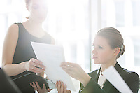 Businesswomen doing paperwork in office