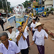 Dan Sai, Thailand residents walk in a parade on opening day at  festivities at Thailand's Phi Ta Khon Ghost festival Friday, June, 22nd, 2012.  The Dan Sai Ghost Festival is unique to the Isan area of Thailand in the east and is part of local beliefs in spirits and ghost and is also a Buddhist merit making festival.  The ghost masks are made from bamboo sticky rice cookers and the costumes usually strips of cloth sewn together.  The origins of the Phi Ta Khon Festival are said to come from Buddha's last great incarnation before attaining Enlightenment.